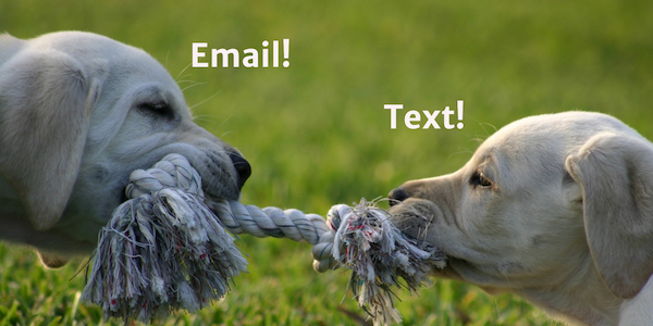 Two puppies tugging on a rope, with the words Email and Text above them.