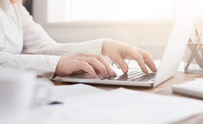 side view of woman's hand on keyboard