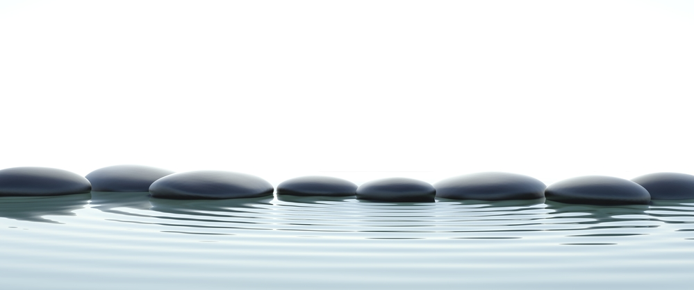 Zen stones in water on widescreen with white background