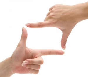 Hands forming a frame. Isolated on a white background.