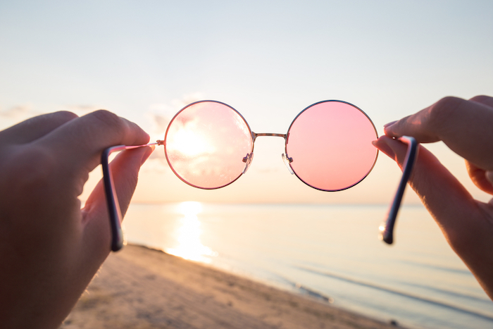 Rose colored glasses looking at a beach scene