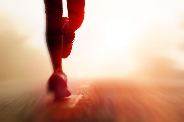 runners feet on road