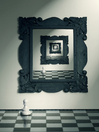 Mirror on the wall and pawn chess and their repeated reflection in the mirror