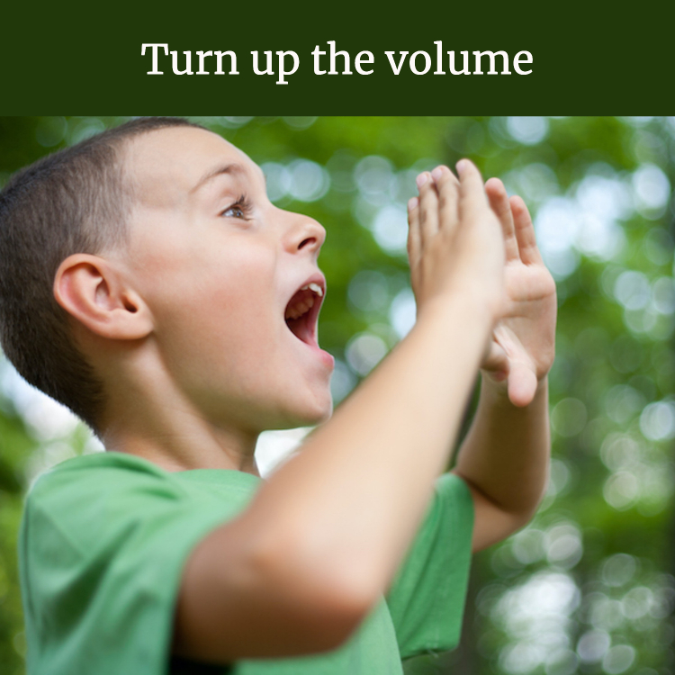"""boy shouting in forest, with words """"Turn up the volume"""""""