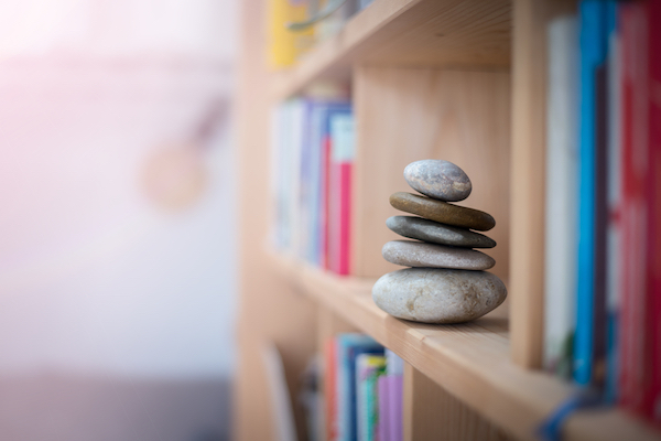 stone cairn on a bookshelf