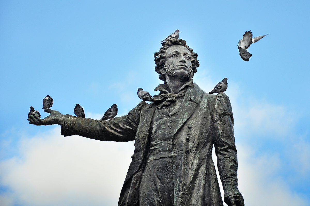 Status of Russian poet Pushkin with pigeons.