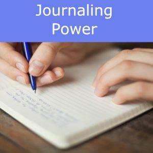Image of hands writing with a pen in a journal