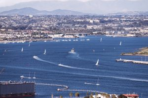 boats leaving wakes in the San Diego harbor
